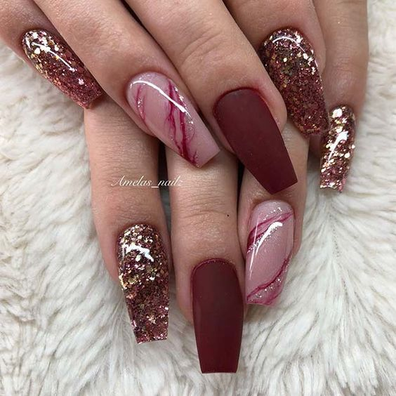 Matte burgundy nails with gold glitter and marble