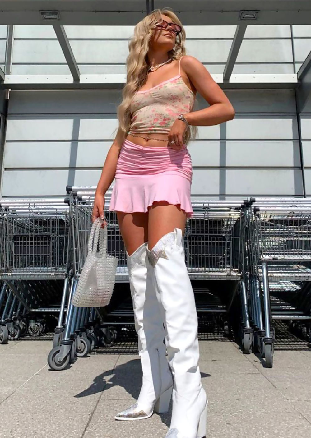 Floral crop top with pink mini skirt and thigh-high white boots for aesthetic outfits