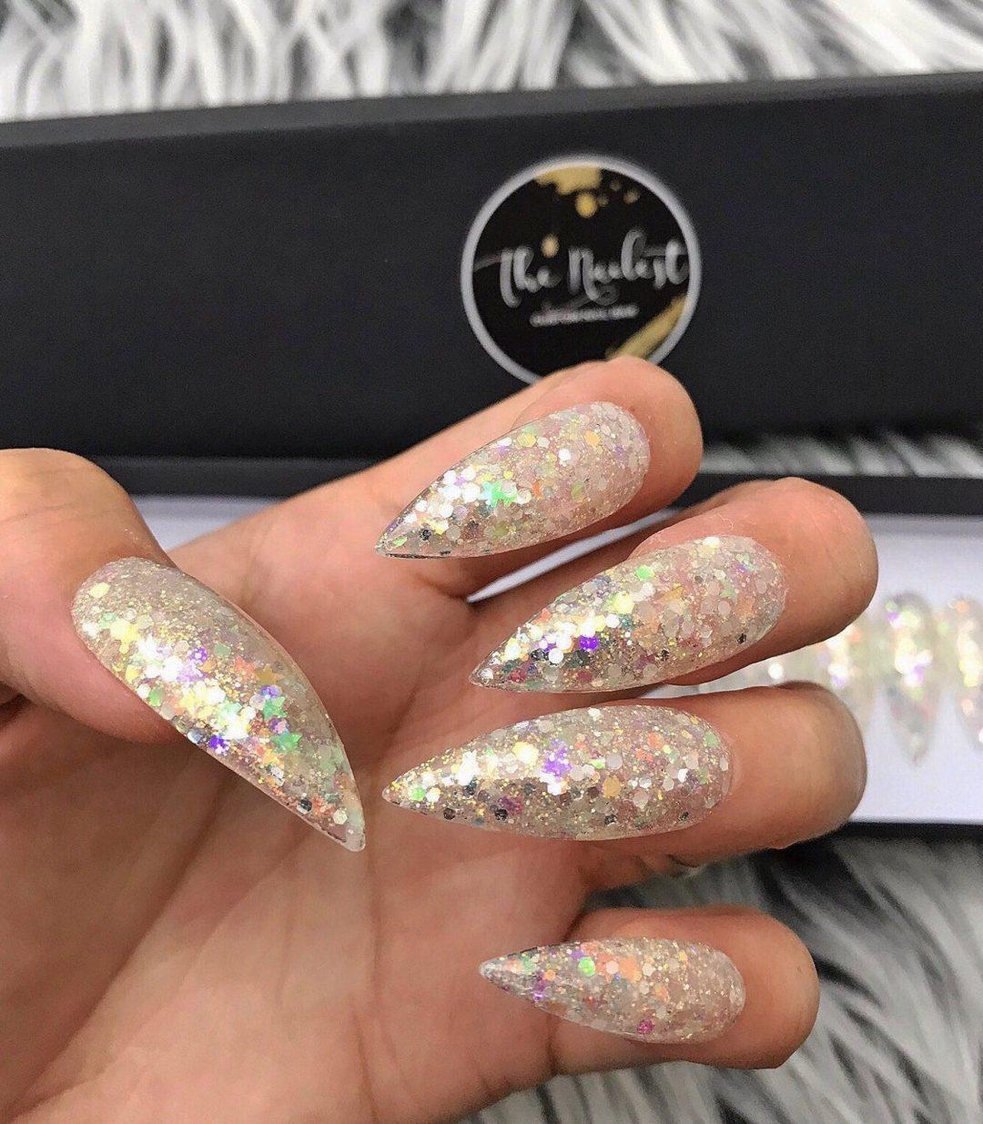 Champagne gold glitter nails in stiletto shape