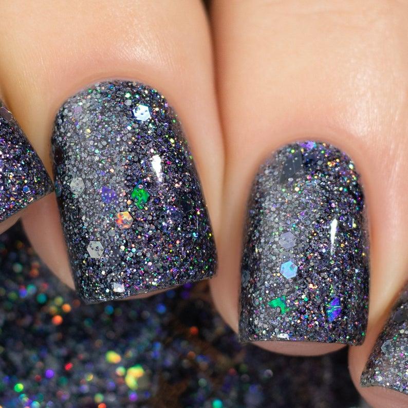 Short dark blue glitter nail polish