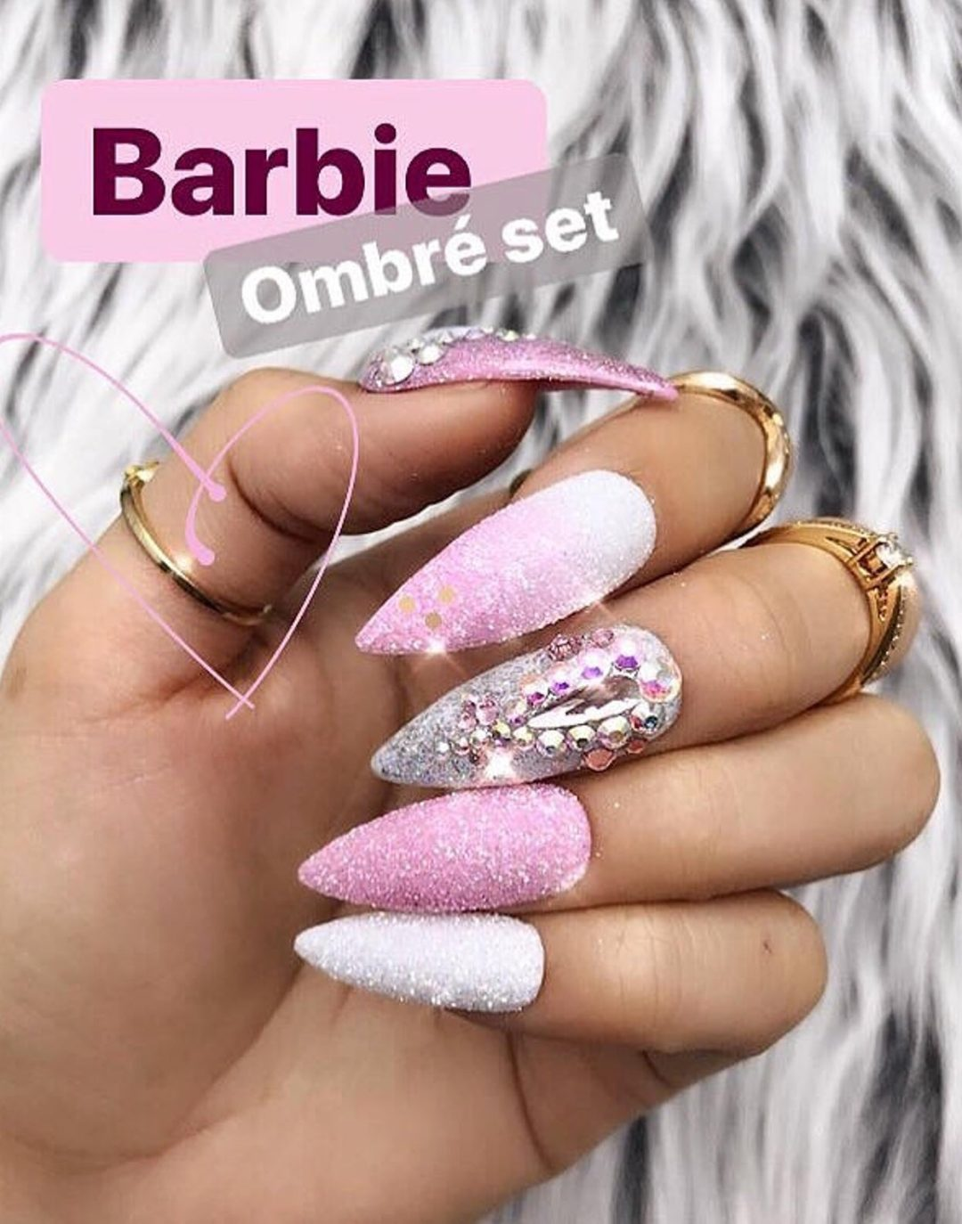 White and pink ombre nails with glitter and rhinestones