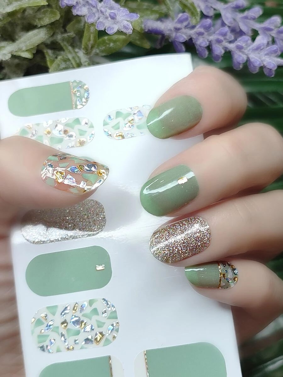Sage green nail wraps with gold glitter