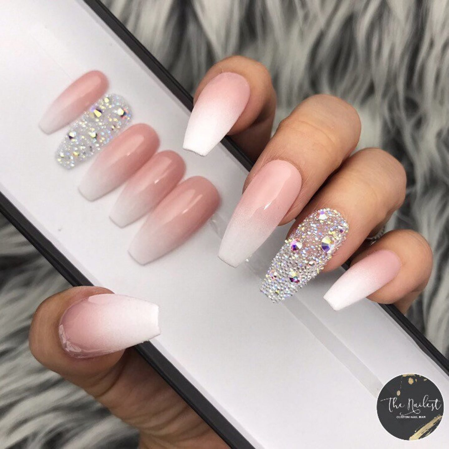 White and pink French tip nails with silver rhinestones