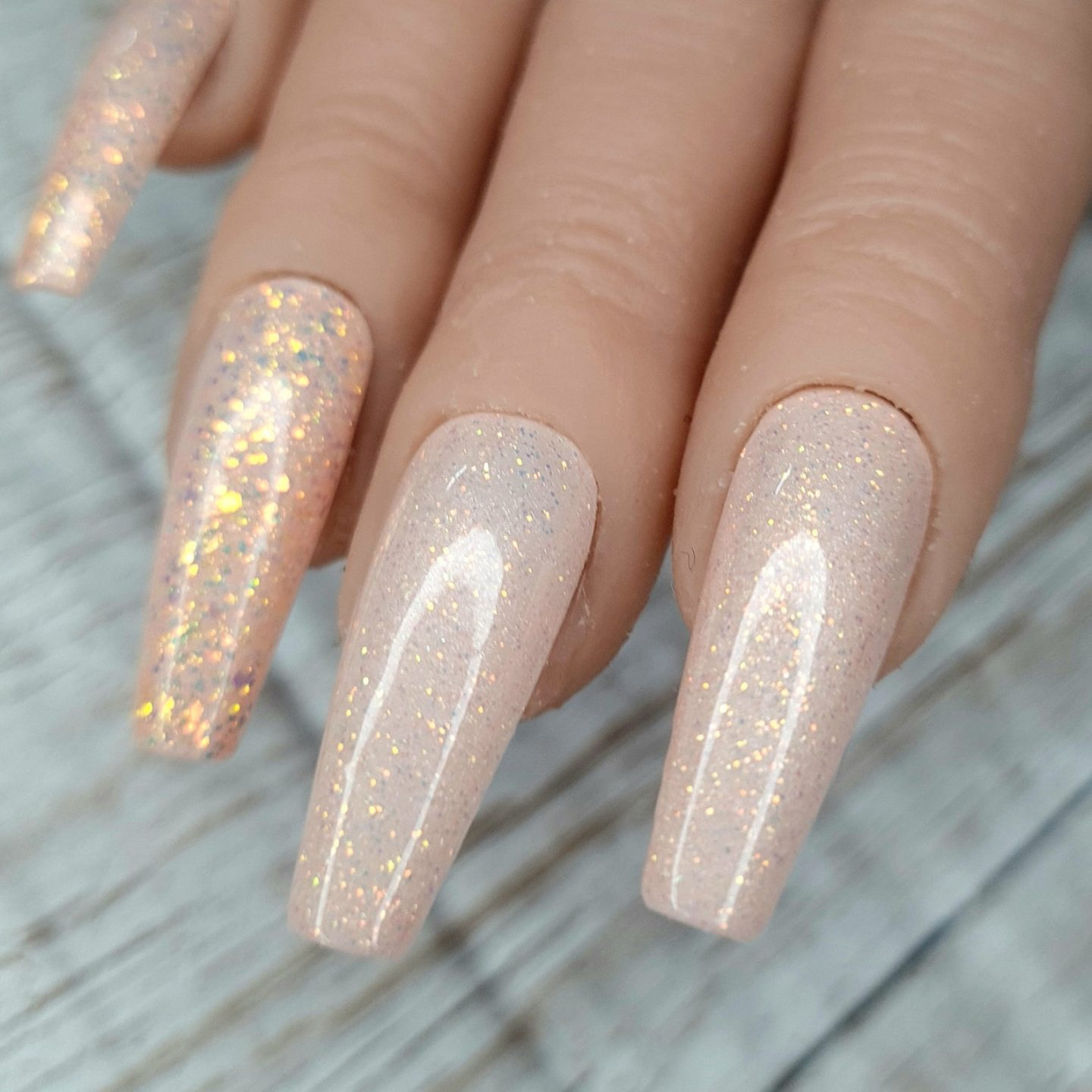 Nude nail designs with gold glitter