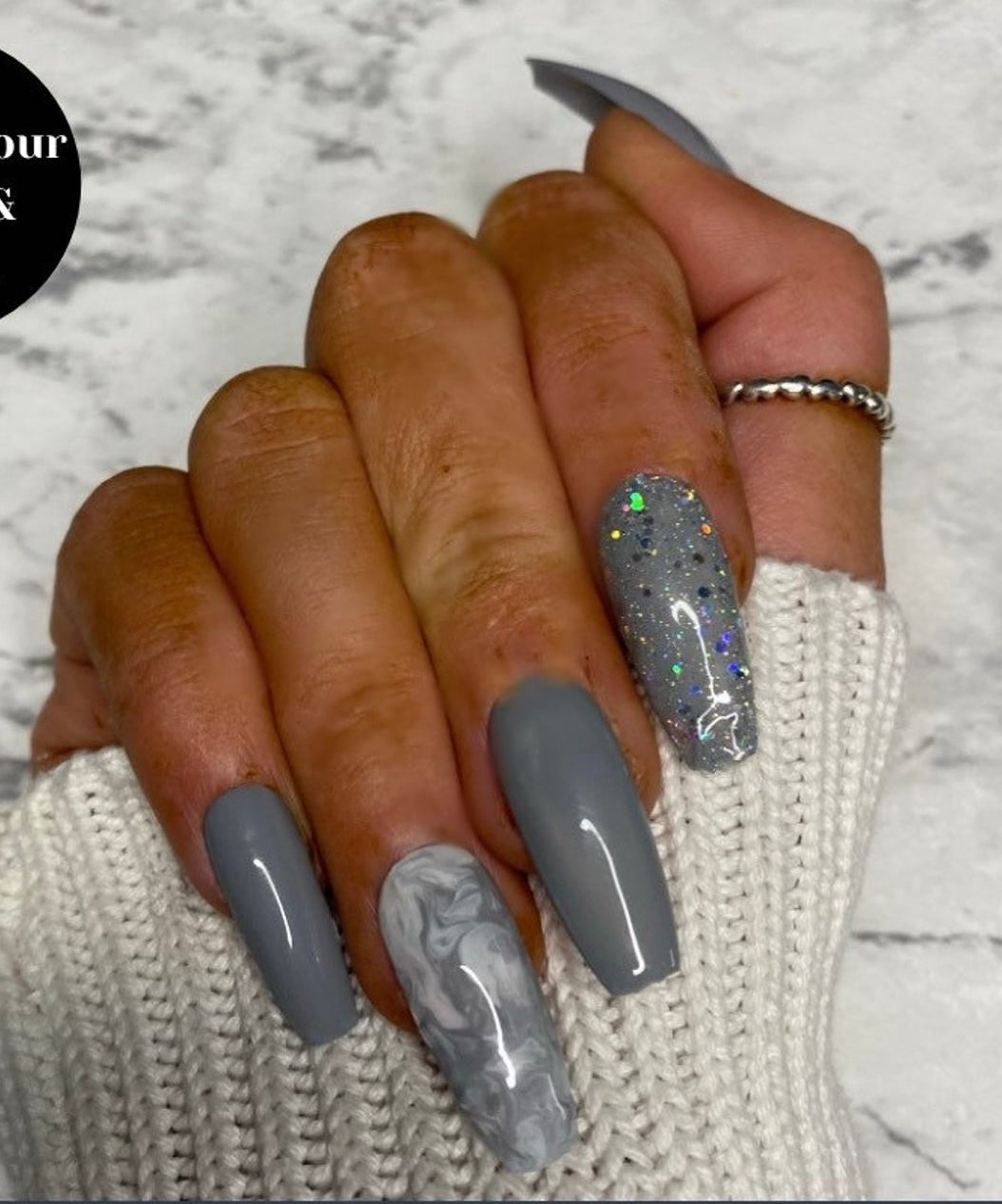 Grey glitter nails with marble nail art