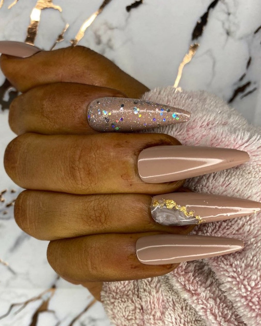 Brown stiletto glitter nails with gold foil