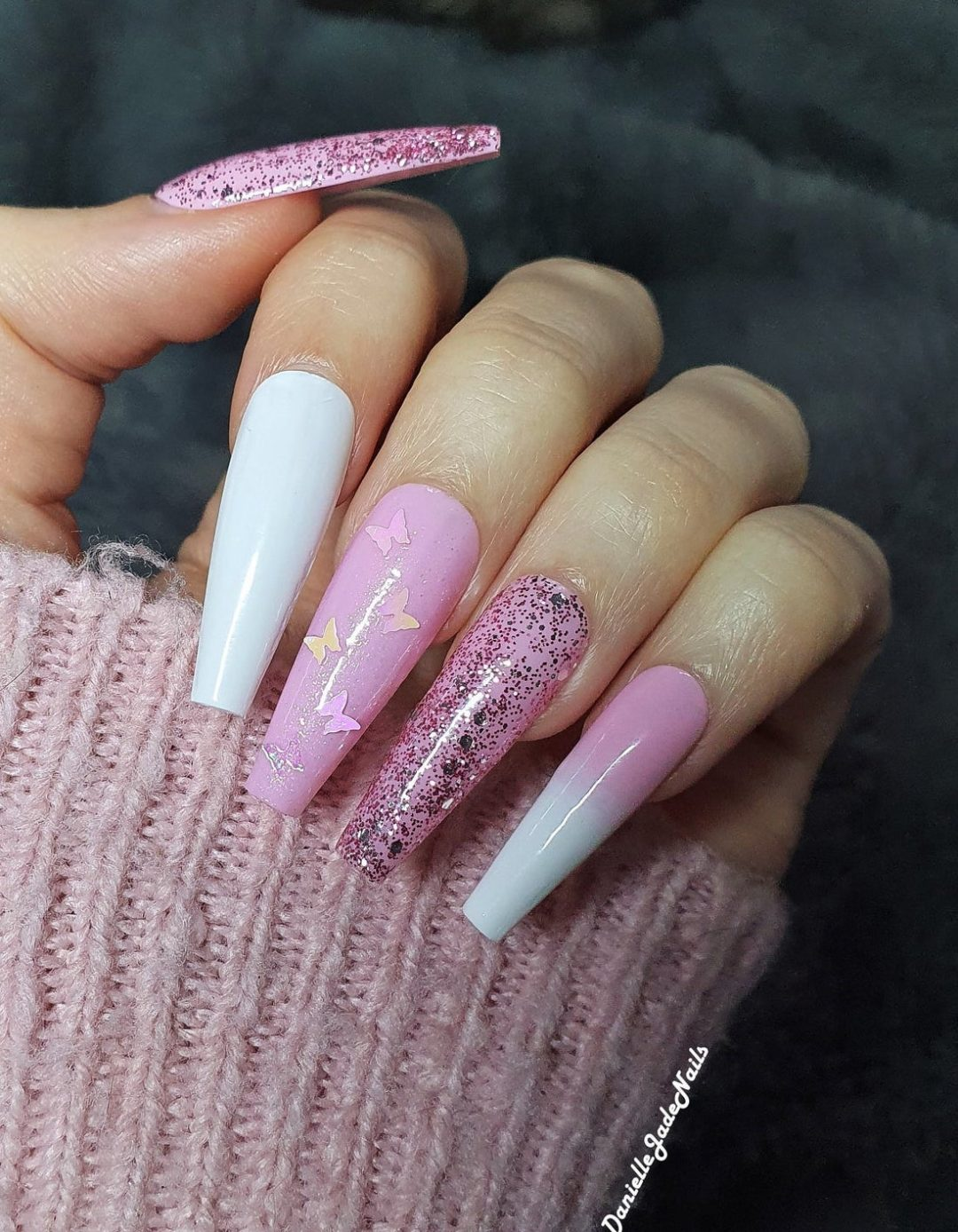 White and pink ombre nails with glitter and butterflies