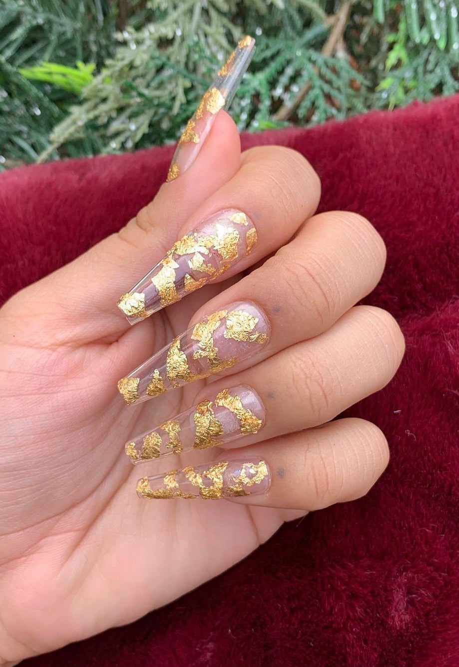 Transparent nails with gold flakes