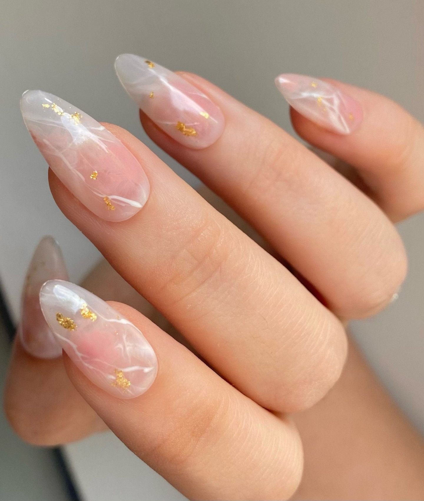 Cute white marble gemstone nails with gold flakes