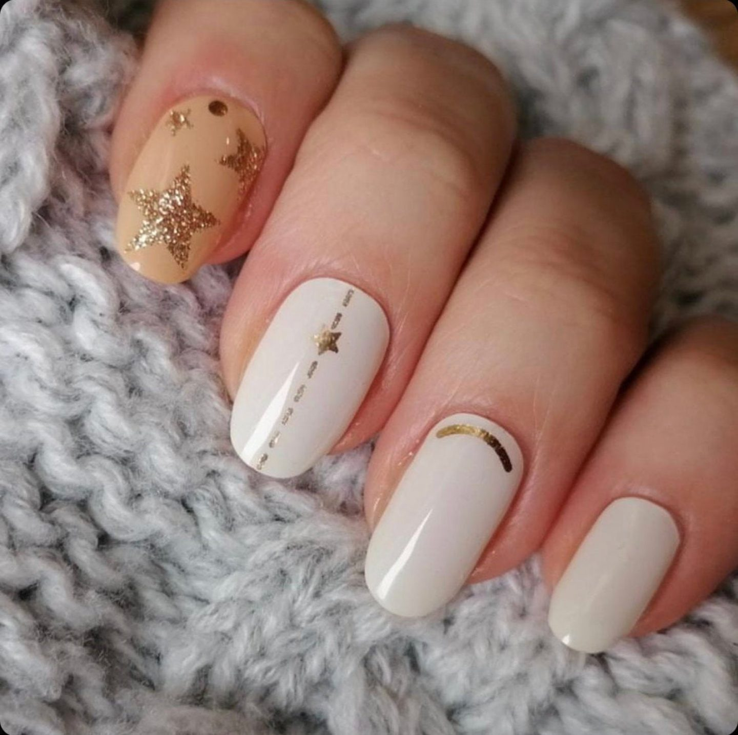 White and nude nail wraps with gold glitter