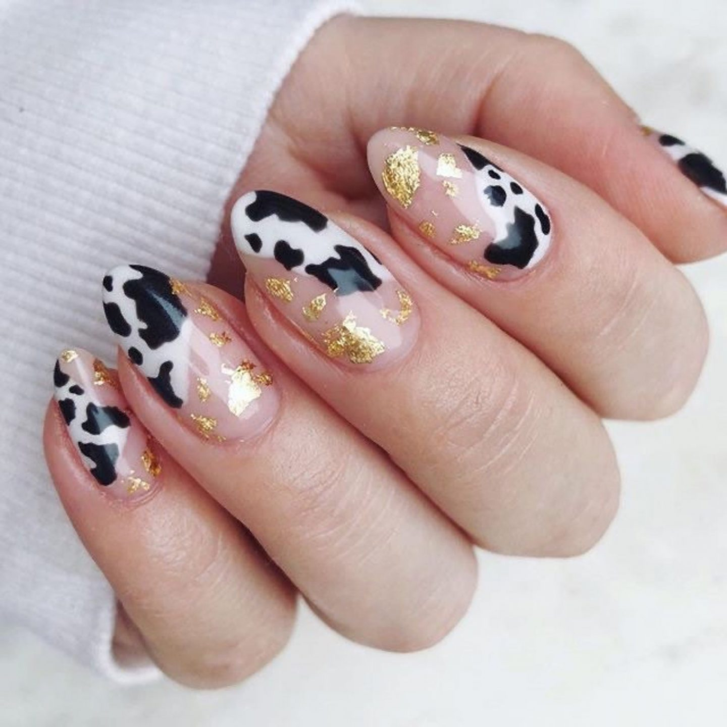 Cute cow print nails with gold foil