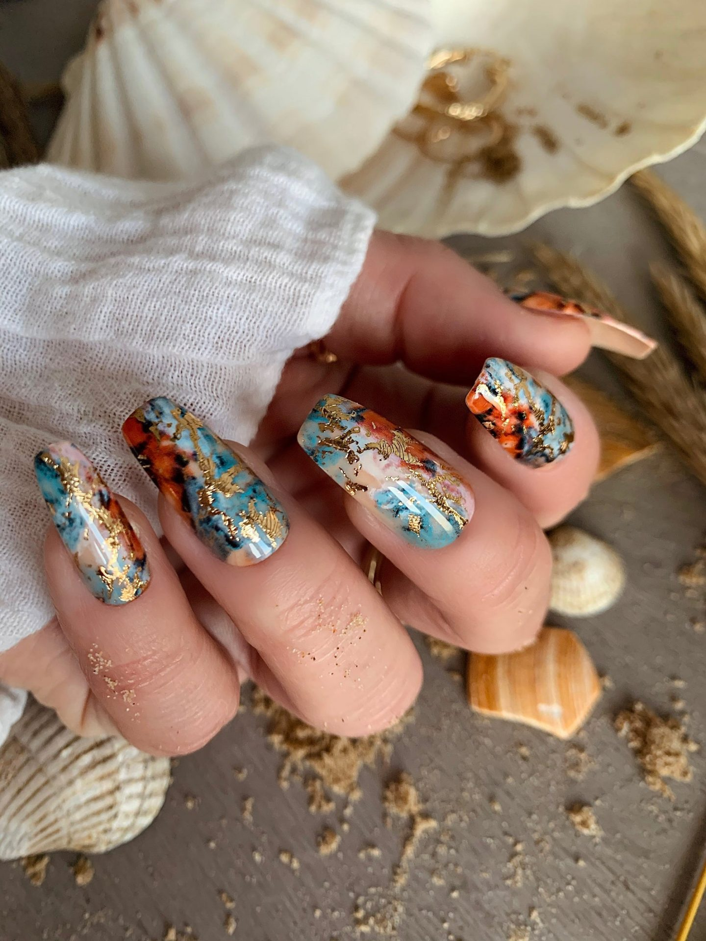 Turquoise and gold marble nails