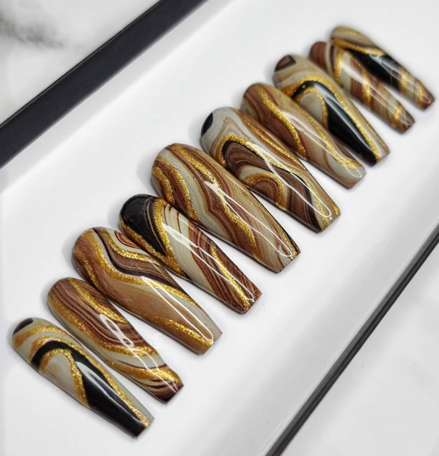 Brown marble nails with gold swirls