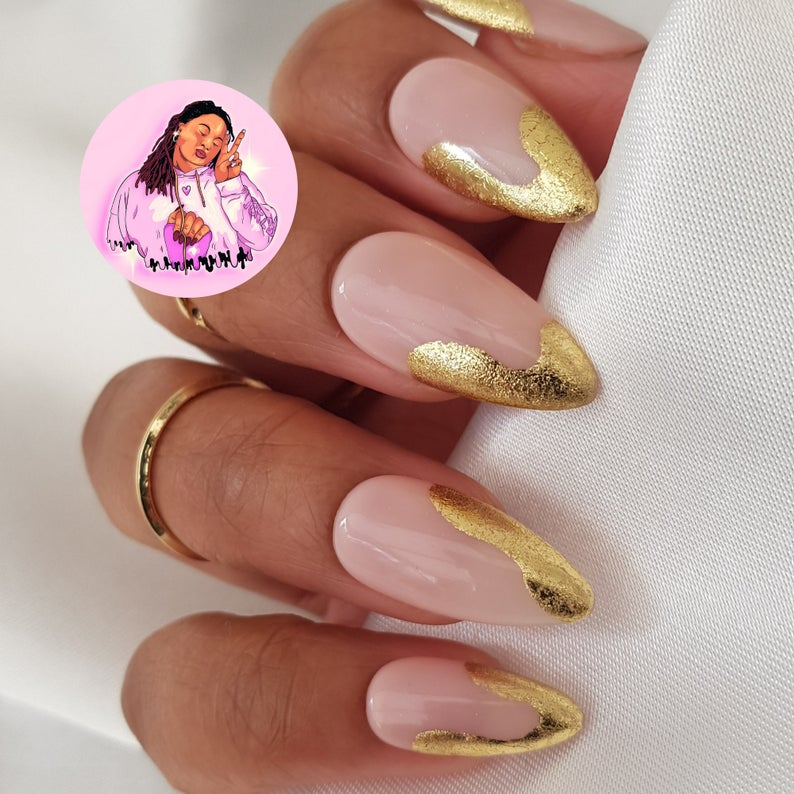 Nude and gold abstract swirl nails with French tips