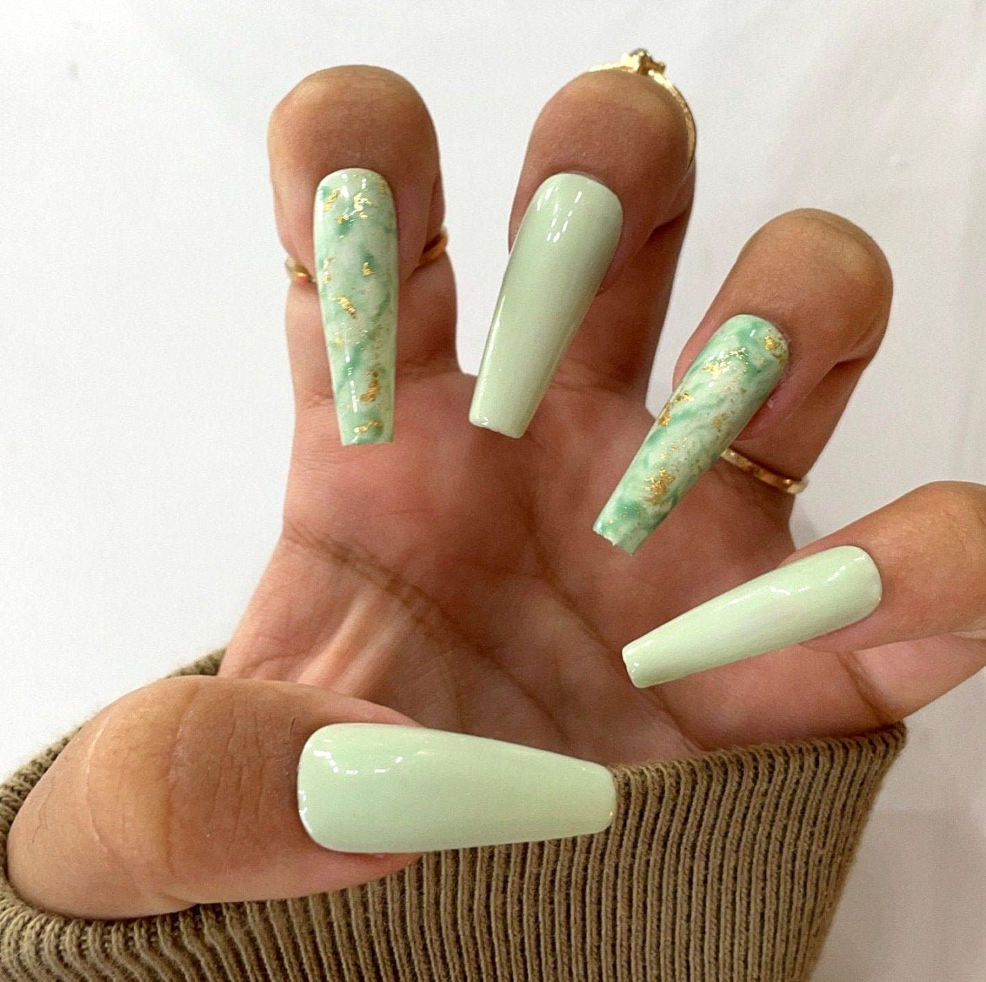 Sage green marble nails with gold foil