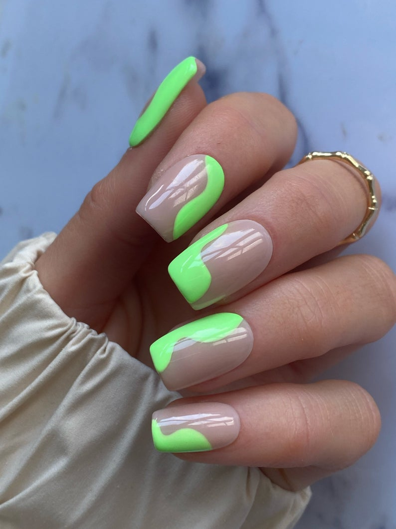 Neon lime green abstract nails with swirls