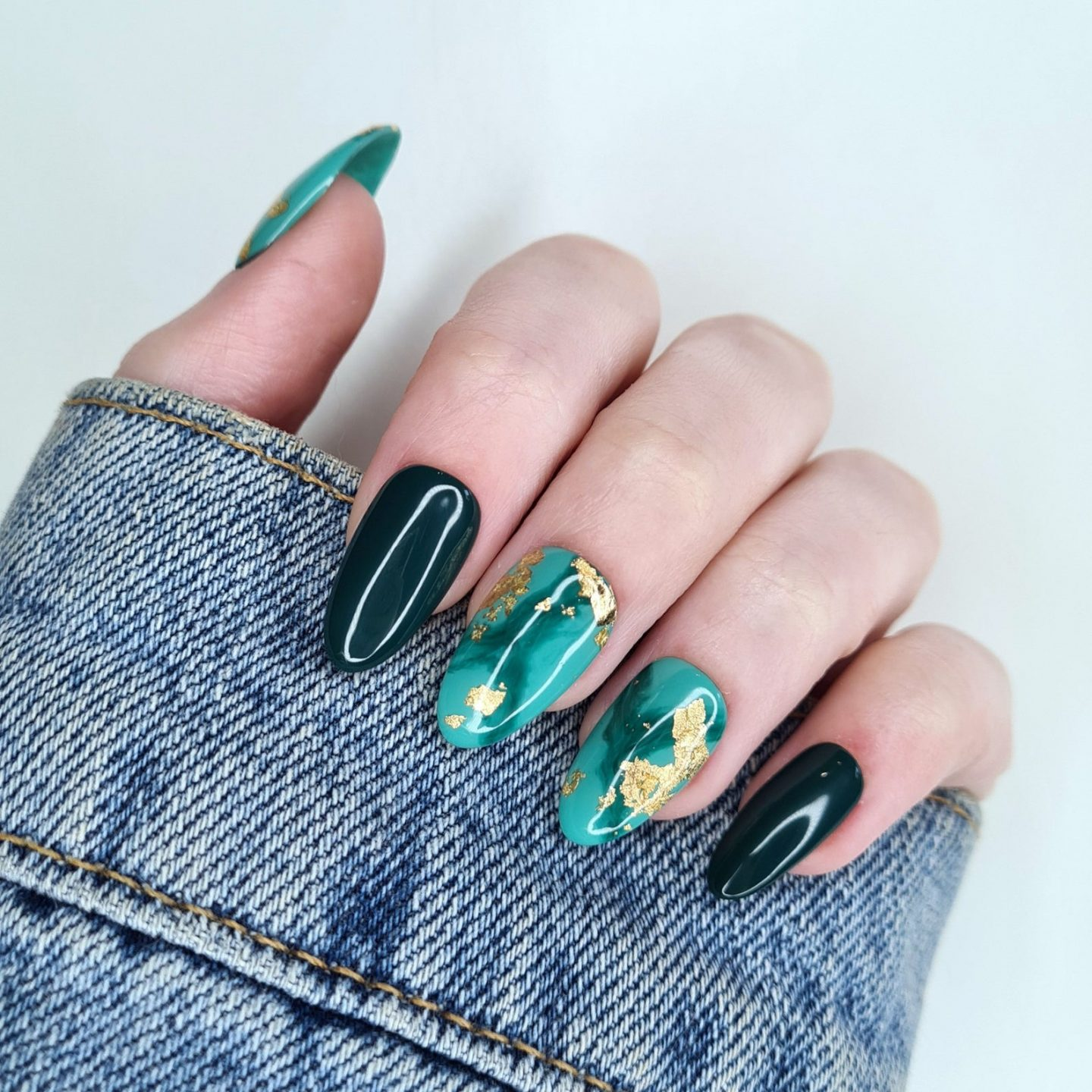 Emerald green marble nail design with gold foil
