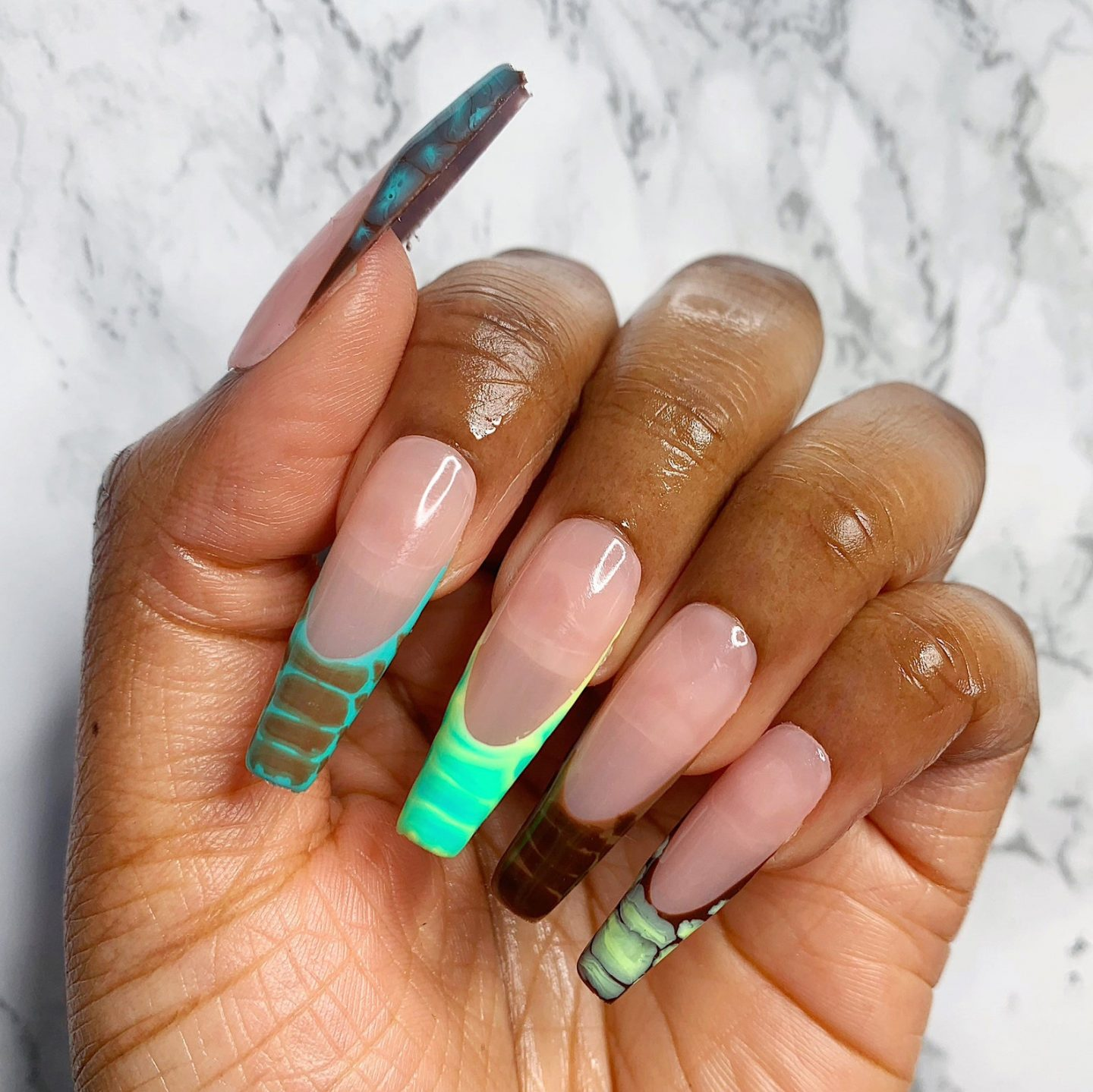 Brown and neon green French tip nails with crocodile nail art