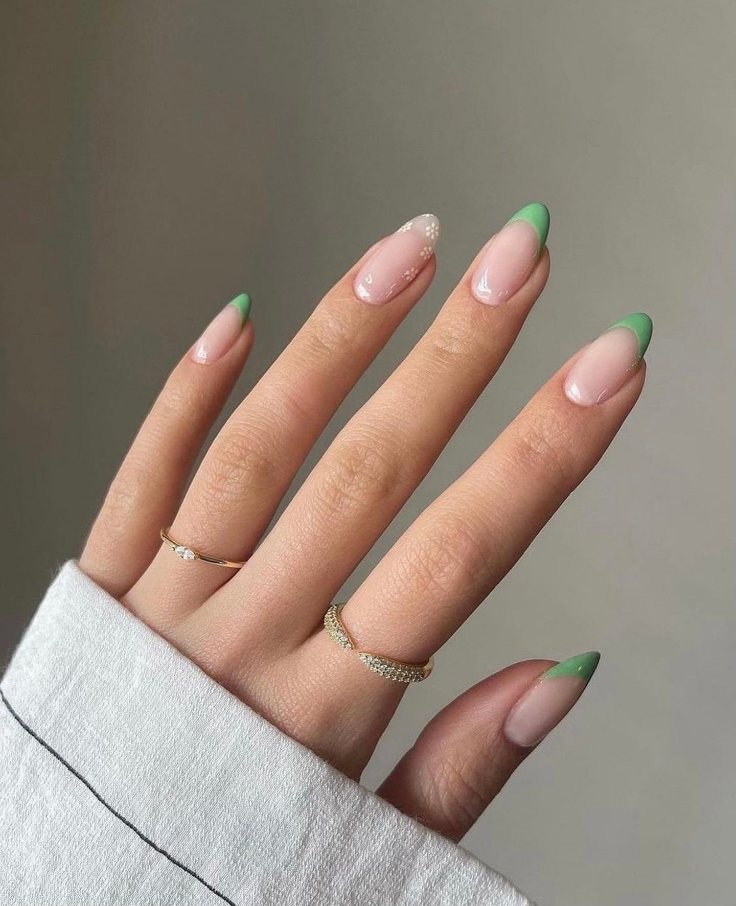 Light green French tip nails with flower nail art