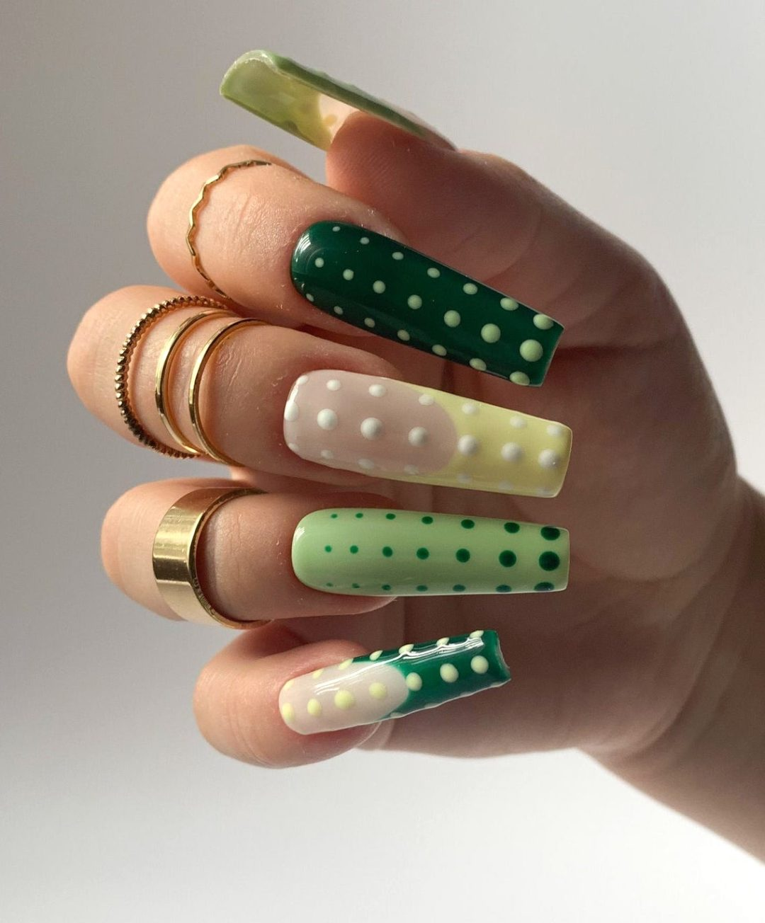 Light and dark polka dot nail designs with French tips