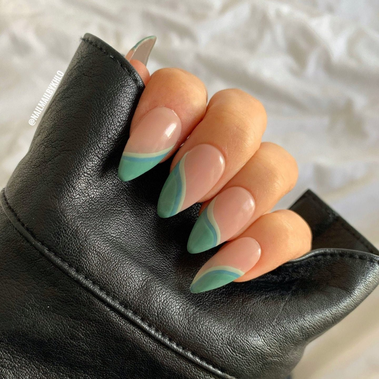 Light green abstract nails with swirls