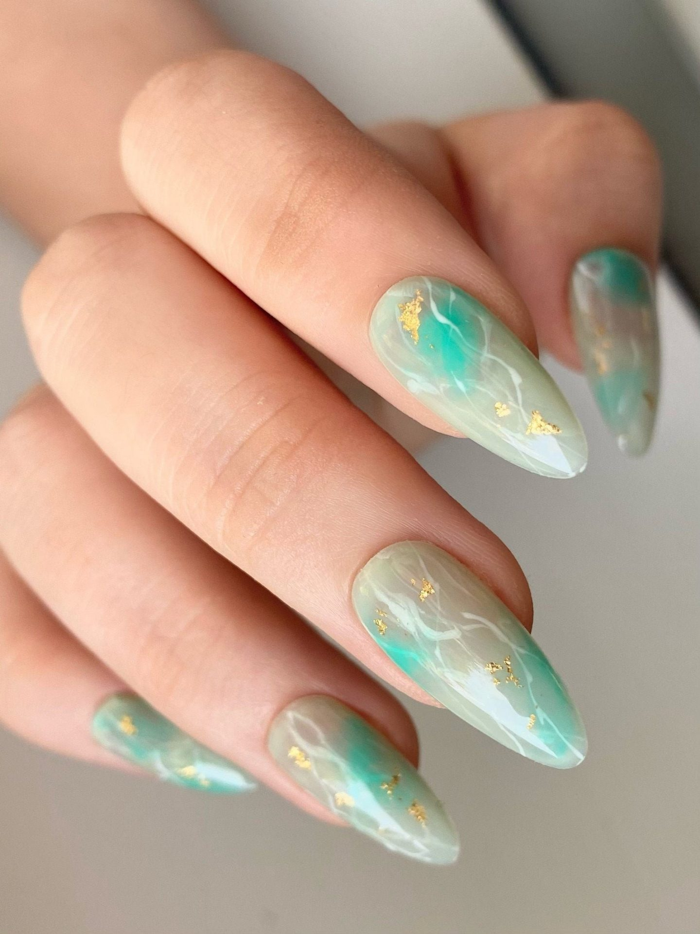 Jade green gemstone nails with gold foil
