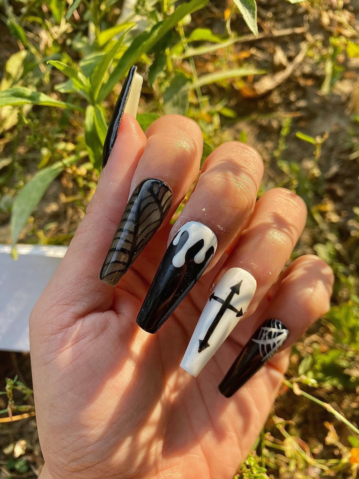 Cute black and white Halloween nails with spiderwebs