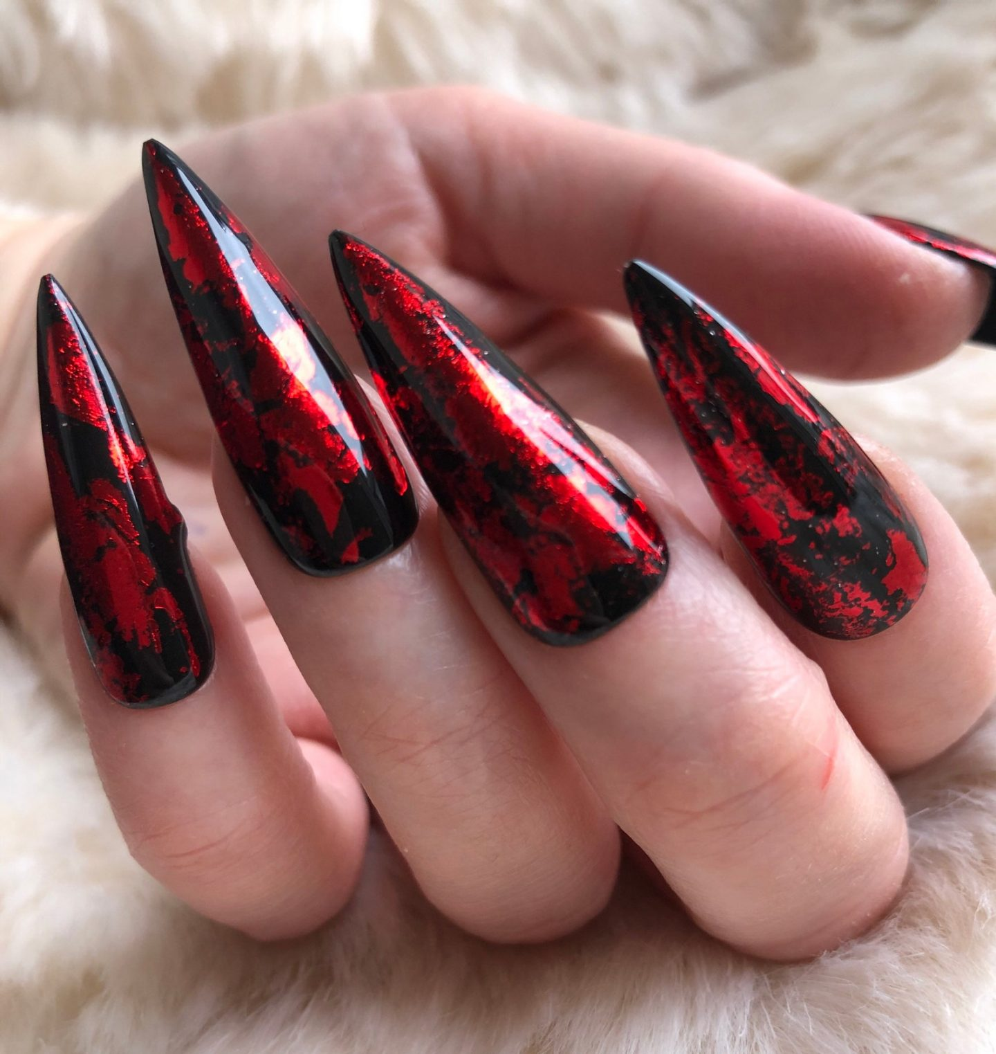 Long black and red Halloween nails in stiletto shape