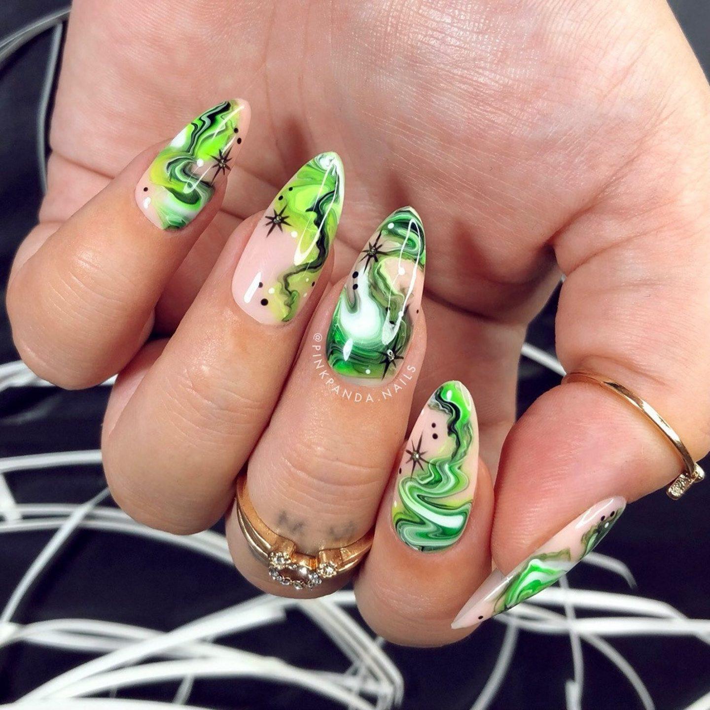 Green Halloween nails with swirls