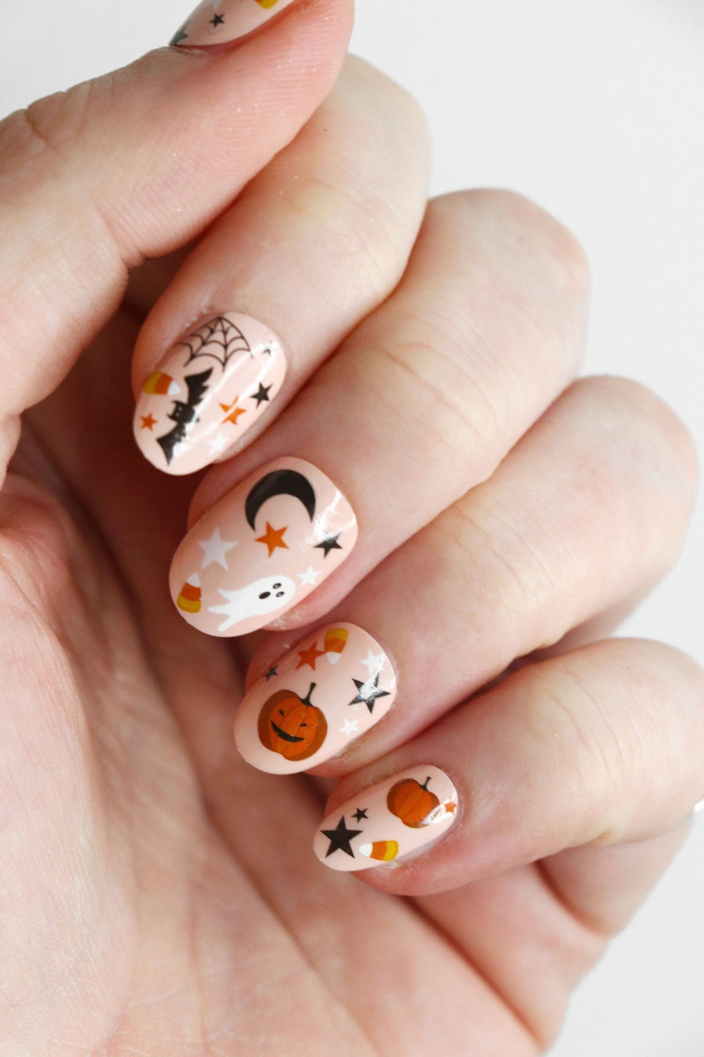 Cute short Halloween nails with ghosts and pumpkins