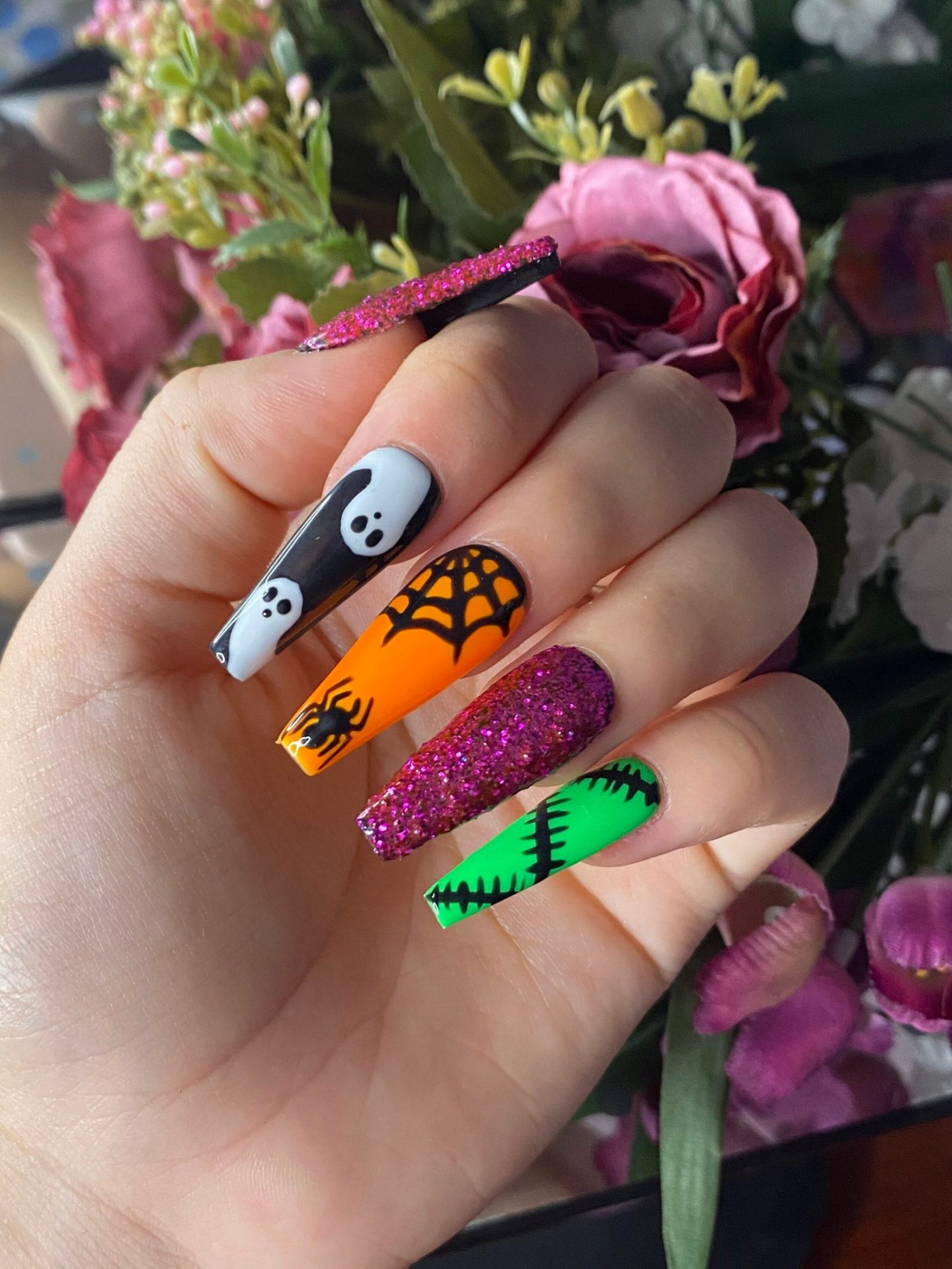 Cute long coffin nails for Halloween in orange, green, purple and black
