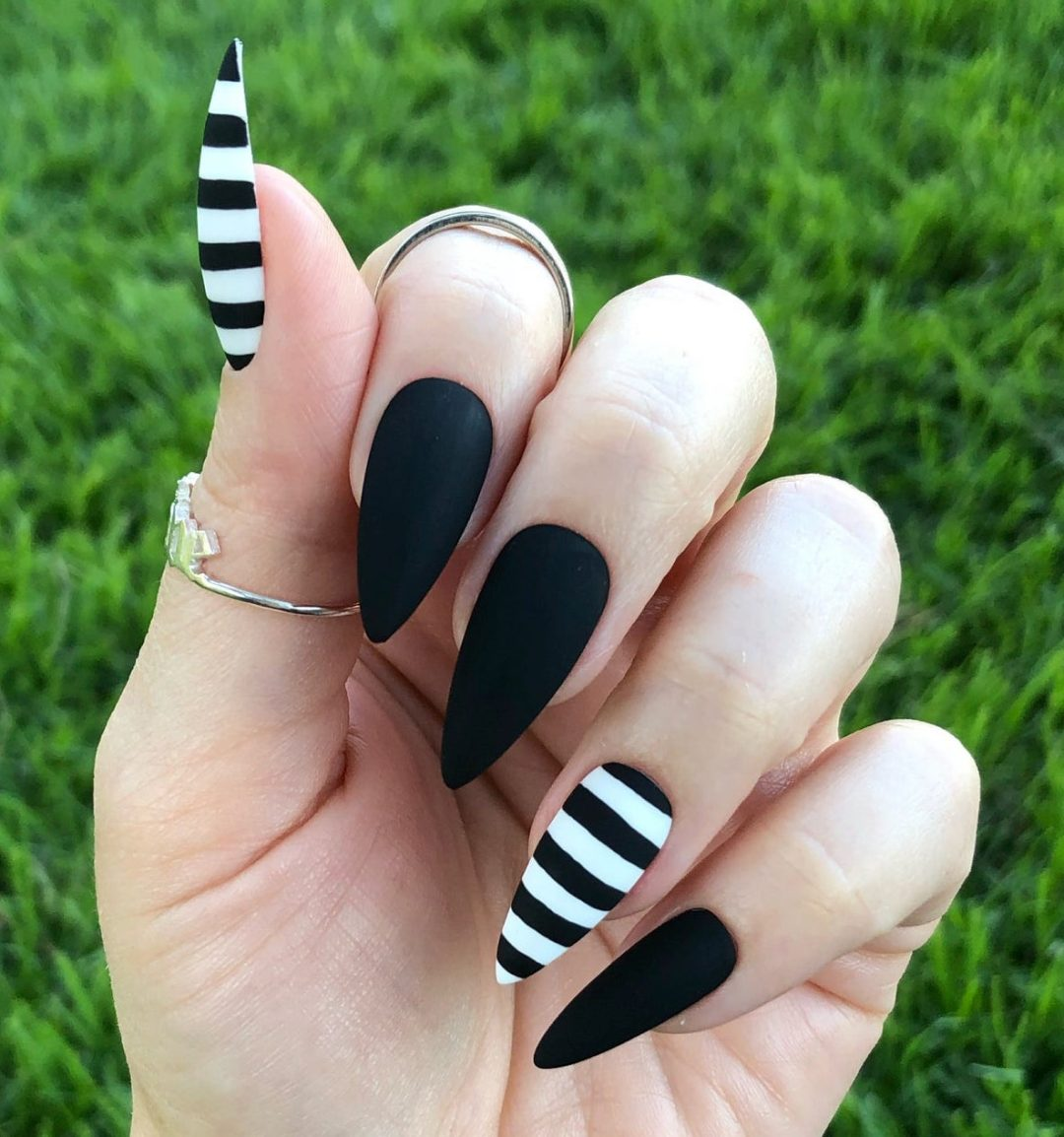 Matte black nails with black and white stripes