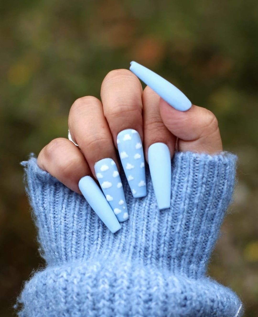 Clouds nail art and light blue nails