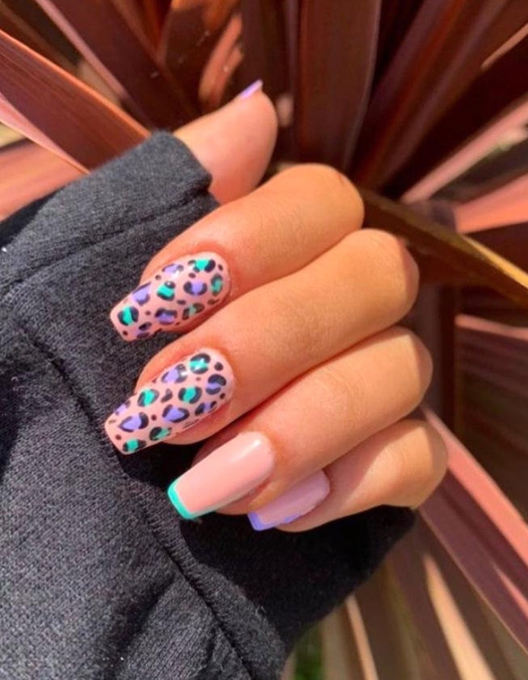 Pink, lavender and teal leopard nails