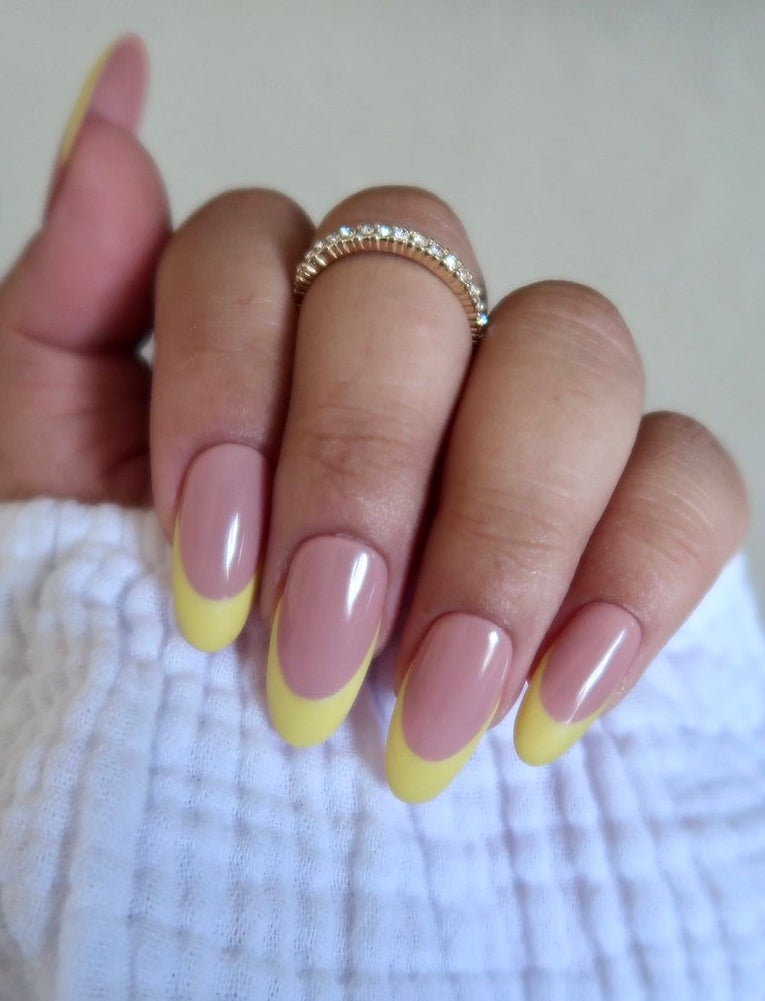 Light yellow French tip nails