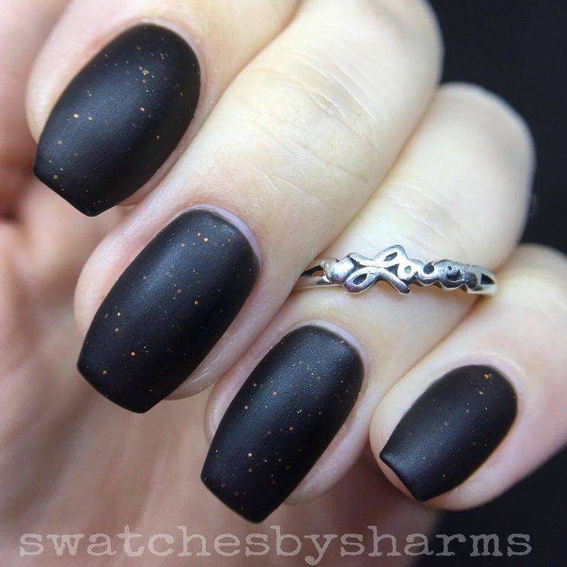 Black matte nails with orange specks