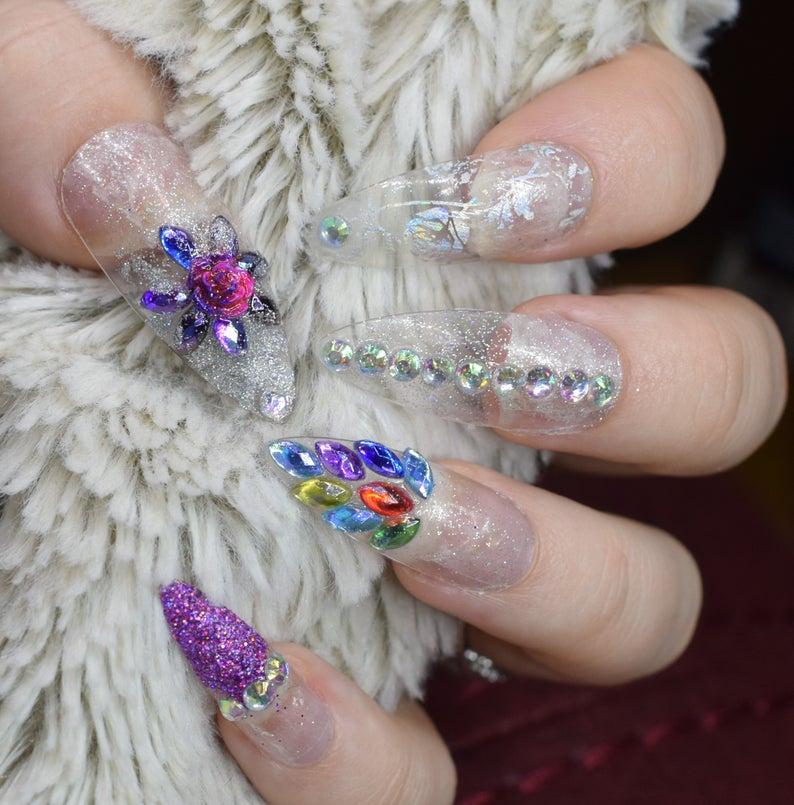 Transparent stiletto nails with rhinestones