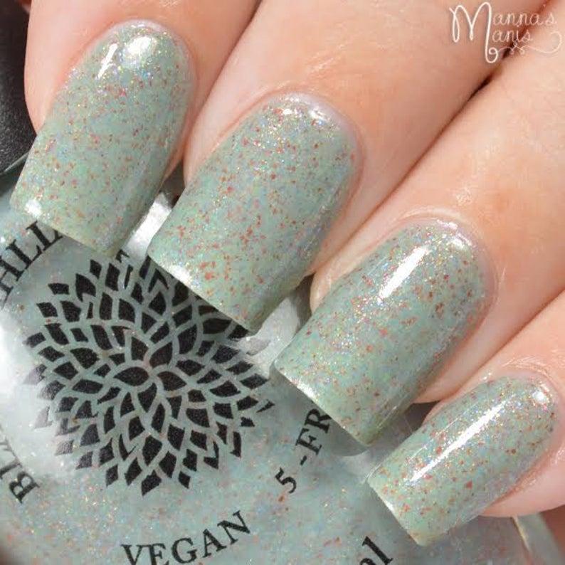 Grey nail polish with specks