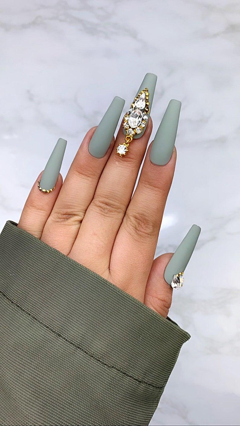 Grey matte nails with rhinestones
