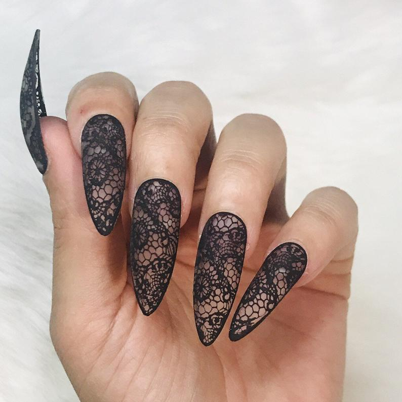 Stiletto nail design with black lace