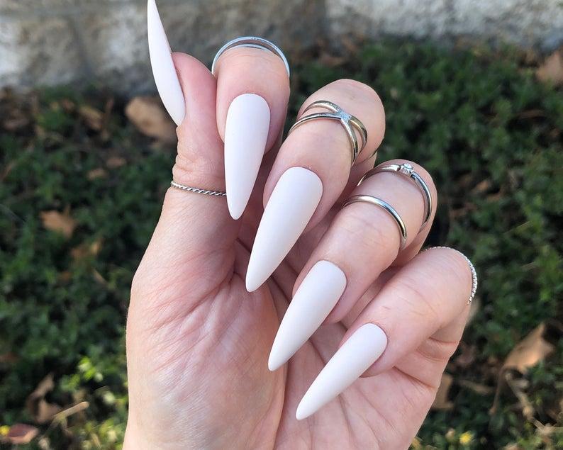 Matte cream stiletto nails