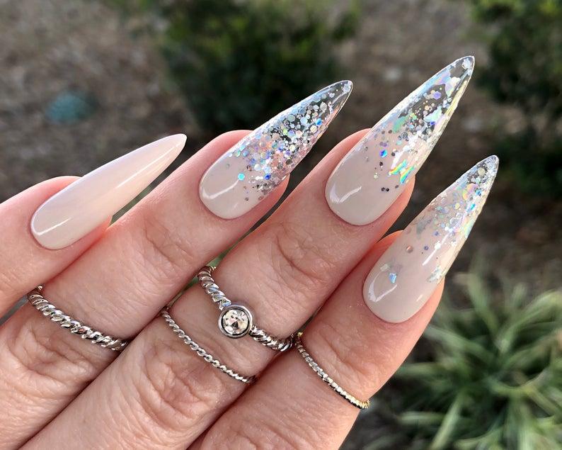 Cream stiletto nails with sparkles