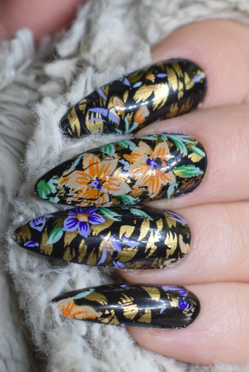 Animal print stiletto nails with flowers
