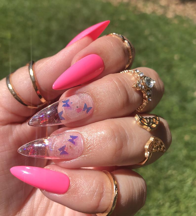 Pink stiletto nails with butterfly design