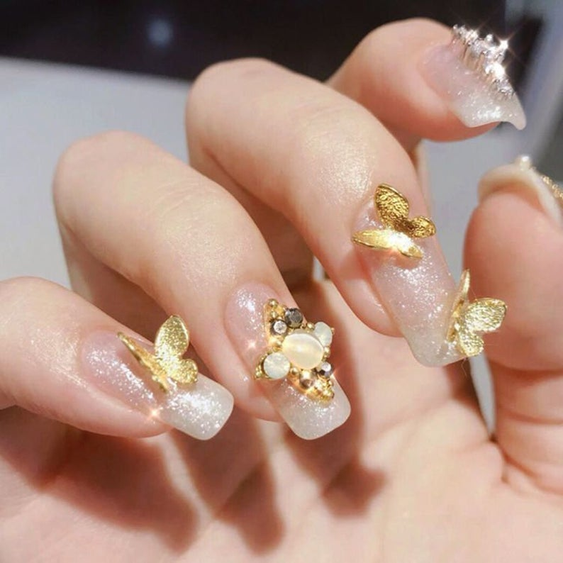 Simple glitter nails with 3D gold butterflies
