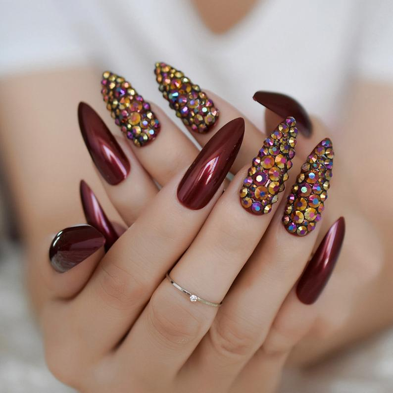 Deep red nails with rhinestones