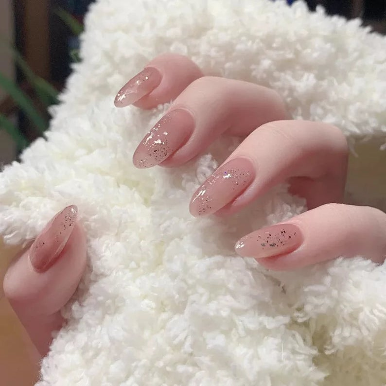 Almond nails with glitters
