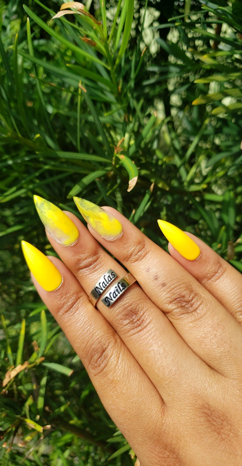 Yellow nails in stiletto shape
