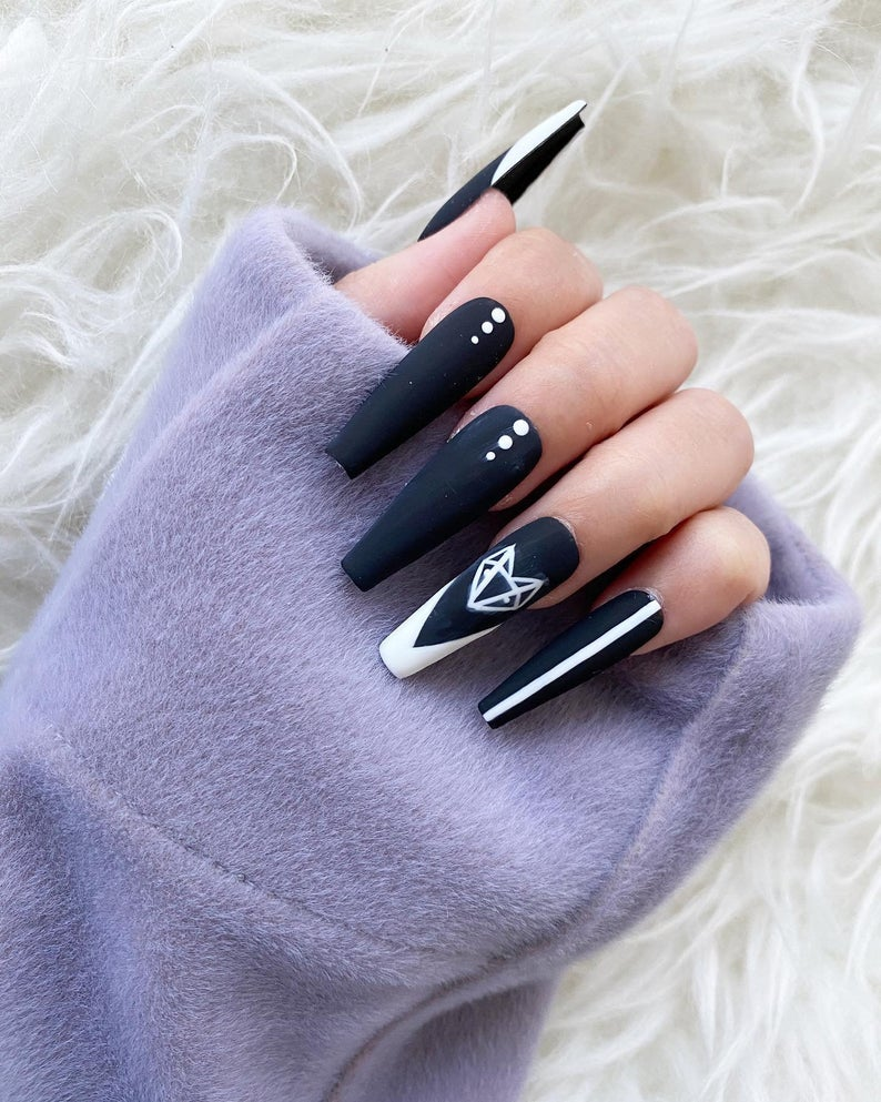 Black matte nails with white accents