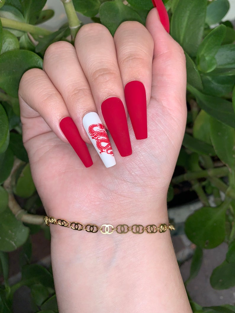Red matte nails with dragon design